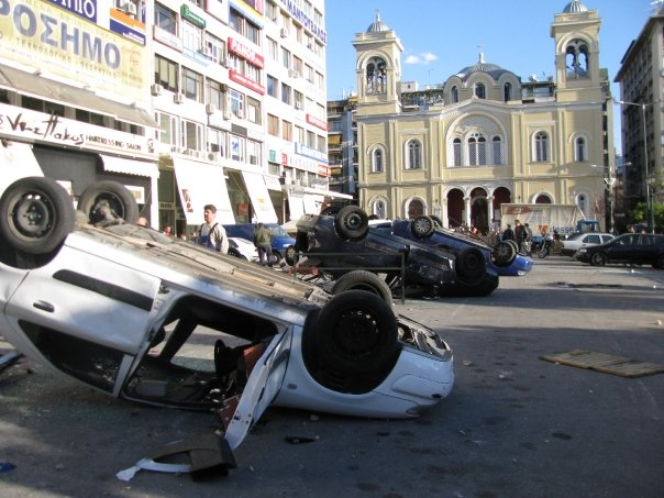Overturned police vehicles in Athens, Greece riots